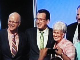 Conn Comptroller Kevin Lembo, Gov. Dannel Malloy, and Lt. Gov. Nancy Wyman after being endorsed for re-election at the Democratic Convention in Hartford on May 16
