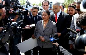 The family of Marcelo Lucero surrounded by reporters. Lucero was stabbed to death in 2008 in what prosecutors say was a string of similar hate attacks.