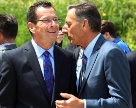 Connecticut Gov. Dannel Malloy, left, talks with Vermont Gov. Peter Shumlin during a break at the New England Governors and eastern Canadian Premiers 38th annual conference, Monday, July 14, 2014, in Bretton Woods, N.H.