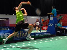 Danish badminton player Flemming Quach returning a volley at the 2014 Yonex Suffolk County Community College U.S. Open Championships.