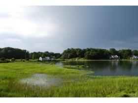 A view of the causeway property owned by Bruce Beinfield from across Farm Creek in Rowayton, Conn.
