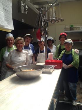 Volunteers from St. Jerome Catholic Church in the kitchen of the Open Door shelter in Norwalk, Conn. They served baked ham and macaroni salad to dozens of low-income residents in the community.