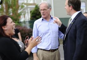 In this Monday, July 28, 2014 photo, Tom Foley, the endorsed Republican candidate for Connecticut governor campaigns, center, talks with New Britain Mayor Erin Stewart, left, and her chief of staff John Healey, right, in New Britain, Conn. Foley is running against Republican John McKinney in Connecticut's Aug. 12 primary for governor.