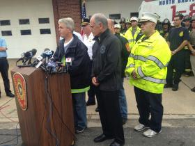 Suffolk County Executive Steve Bellone, Secretary to Governor Cuomo Larry Schwartz, and members from the Suffolk Police and North Babylon Fire departments addressing the media on the state of the storm on Wednesday August 13th, 2014.