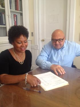 Michelle James, executive director of the Community Action Agency of Western Connecticut,  reviews a document with the agency's finance director, Gary DelVecchio, at the group's headquarters in Danbury, Conn.
