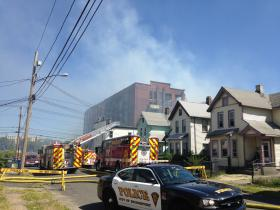 Homes across the street from the former Remington Arms factory burned on Tuesday, Aug. 19, 2014.