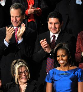 Eric Schneiderman (top left) applaud first Lady Michelle Obama during President Barack Obama's State of the Union address on Capitol Hill in Washington, Tuesday, Jan. 24, 2012.