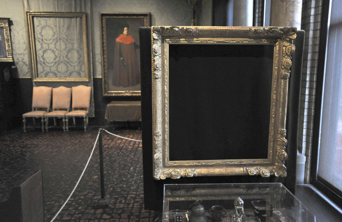 "Thieves took ""Storm on the Sea of Galilee,"" by Rembrandt, which once hung on the wall in the left background and ""The Concert,"" by Vermeer, which once occupied the frame in the right foreground. The empty frames remain on display at the Isabella Stewart Gardner Museum in Boston."