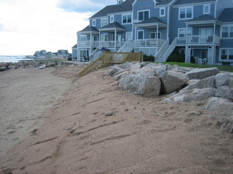 A new riprap wall (boulders that let water through) in East Haven with a sand dune that will eventually have beach grass