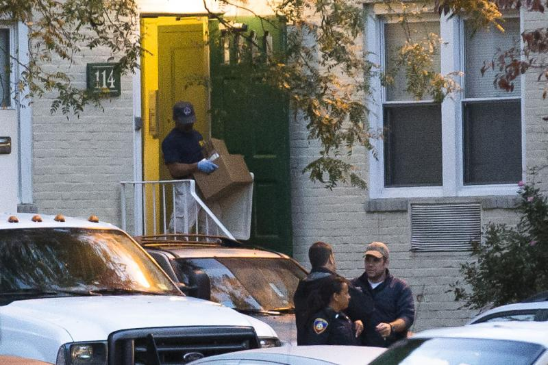 A federal agent removes evidence from the apartment complex where Miriam Carey is believed to have lived in Stamford, Conn., Friday, Oct. 4, 2013.