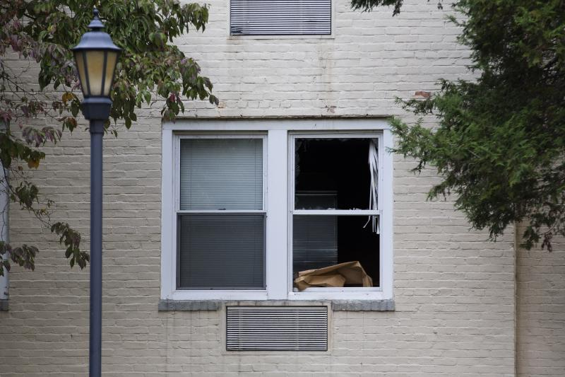 The window of the apartment where Miriam Carey is believed to have lived remains broken after police used the entry point to secure the space, Friday, Oct. 4, 2013, in Stamford, Conn.