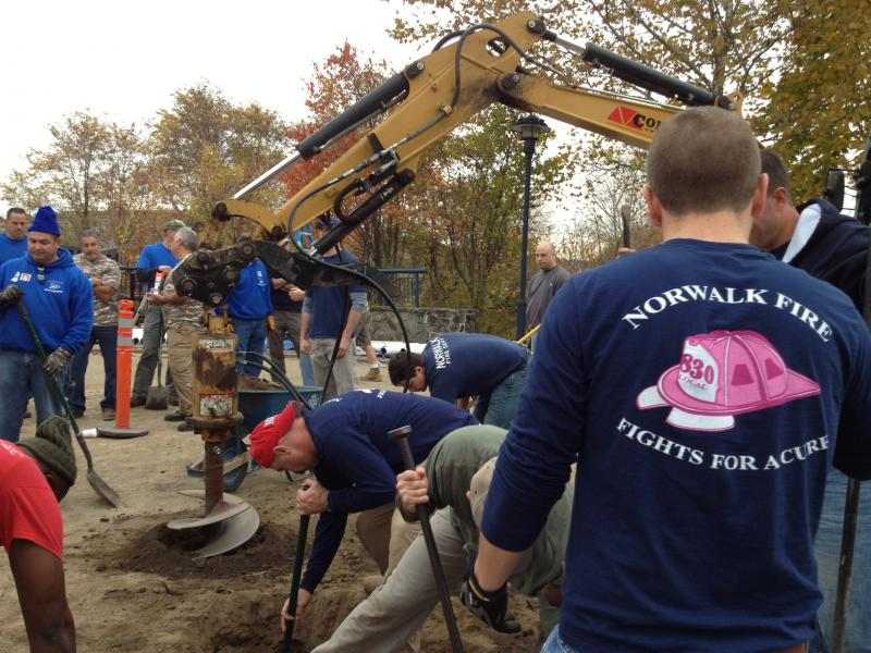 Many of the volunteers building the new playground at Oyster Shell Park in South Norwalk are firefighters