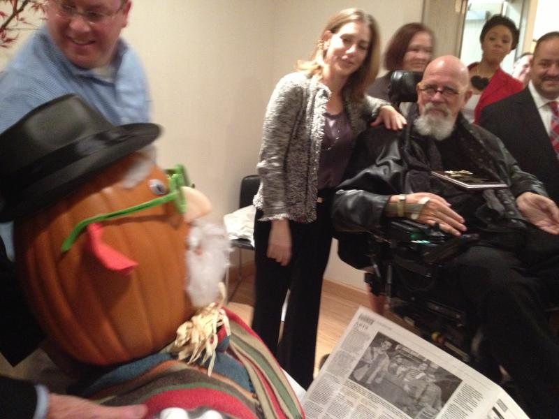 Chuck Close, with Rachel Goslins, the Executive Director of the President's Committee on the Arts & Humanities, meets a pumpkin-headed scarecrow version of himself, made by Bridgeport students