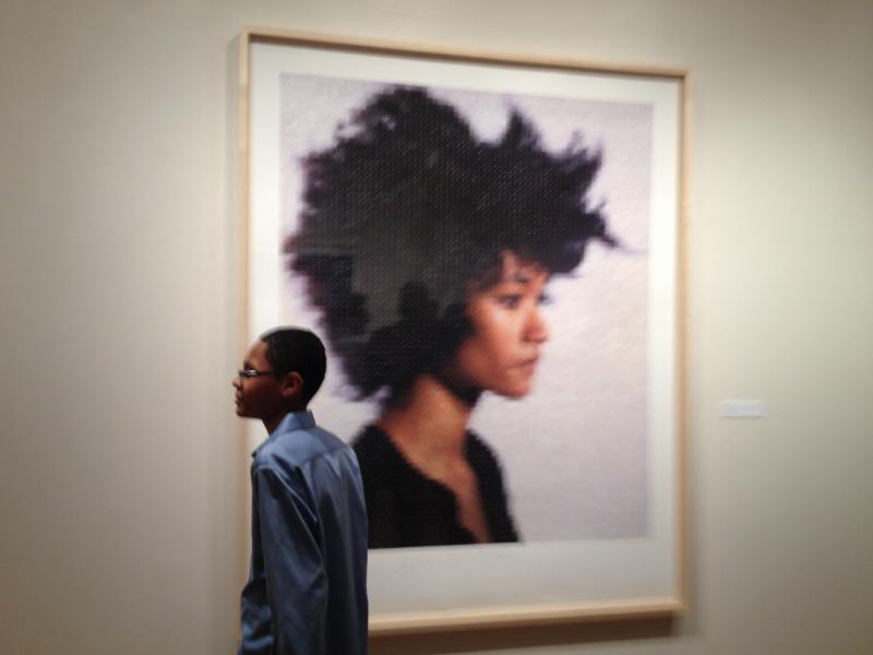 Bridgeport student Chunjang Bruynder with one of Chuck Close's portraits