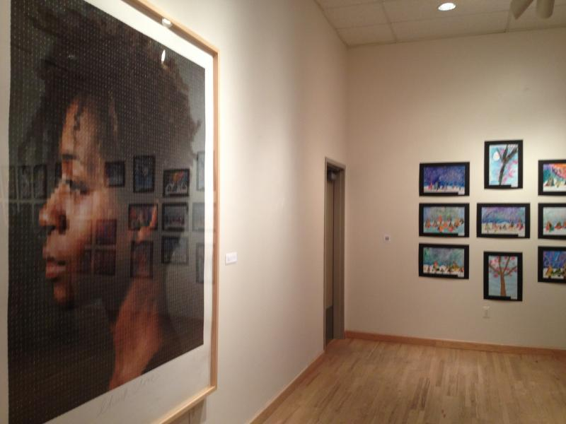 Chuck Close's artwork hangs next to the work of Bridgeport students at the gallery at Housatonic Community College