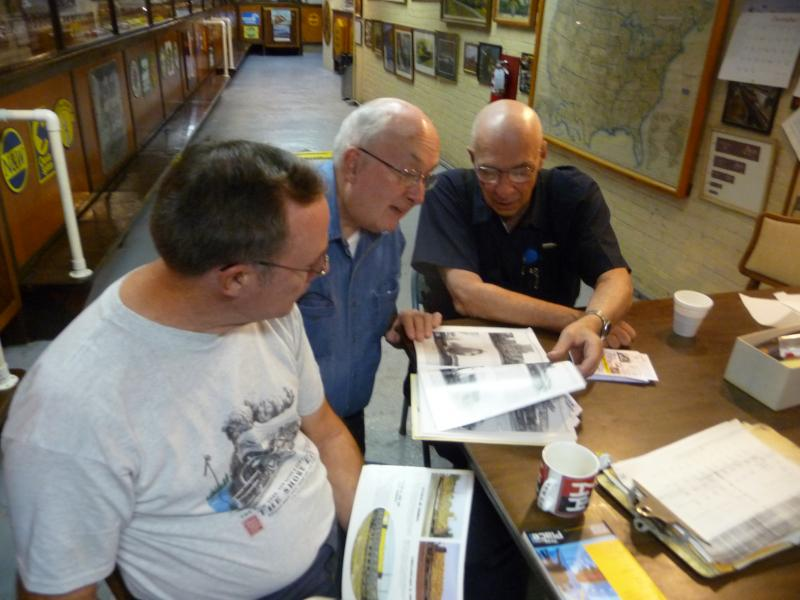 Members of the Stamford Model Railroad Club check historical photos of trains for details