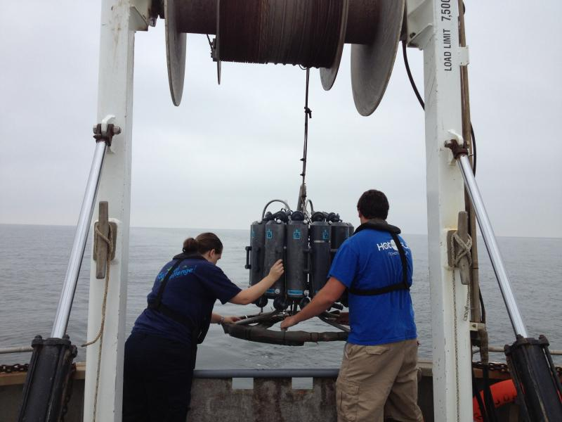 Crew on the John Dempsey lower a sensor into Long Island Sound to determine dissolved oxygen levels