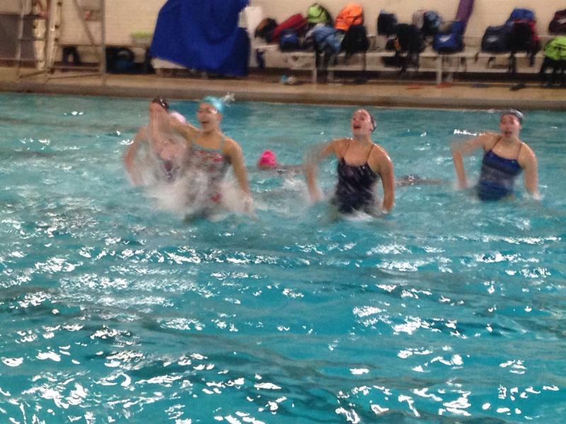 The New Canaan YMCA synchronized swimming team