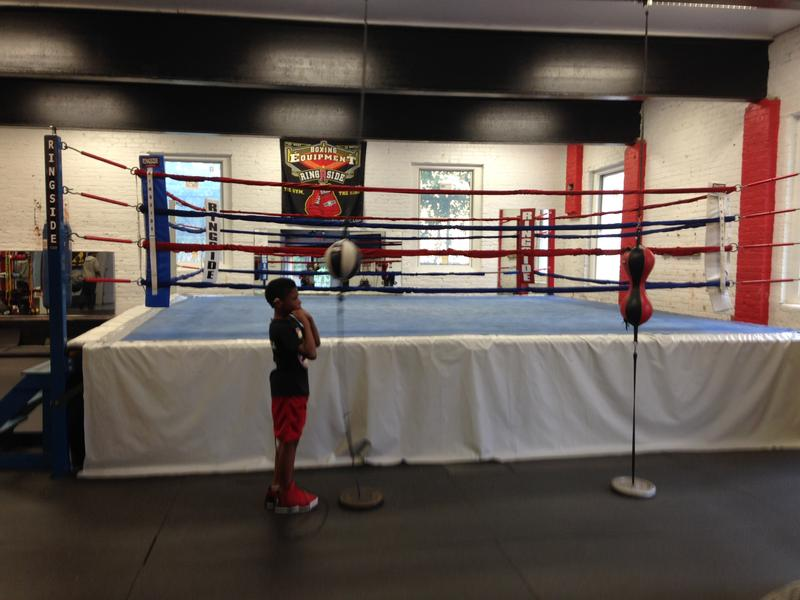 A young boxer practices at Elephant in the Room Boxing Club