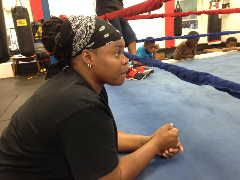 Devonne Canady watches as her young boxers spar