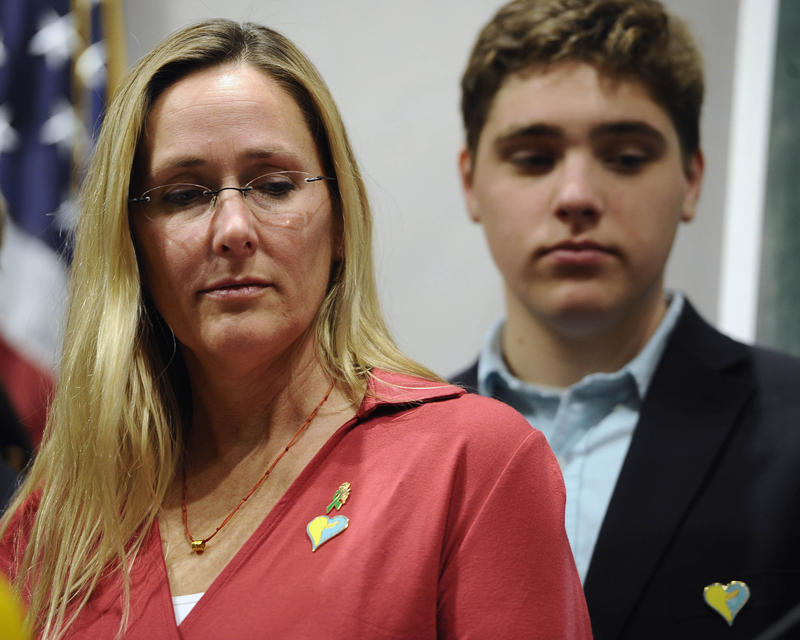 Scarlett Lewis, mother of Sandy Hook School shooting victim Jesse Lewis, and son JT at a news conference in Hartford, Conn., in 2015.