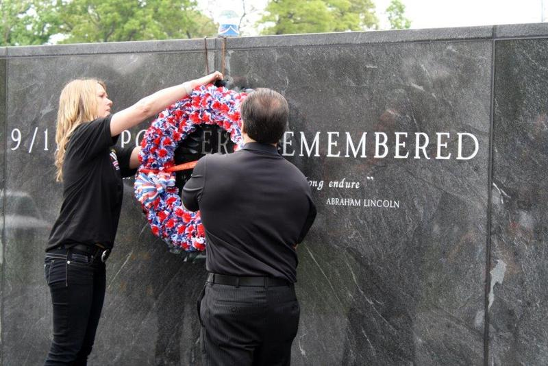 Attendees of the 2014 ceremony at 9/11 Responders Remembered Park hang a wreath.