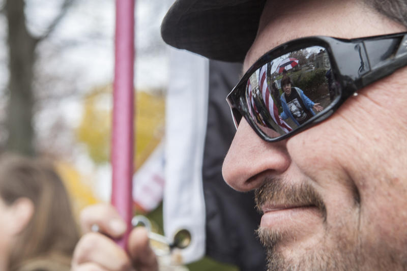 Jason Sylvia, a Windsor Locks resident, listens to another protestor during a rally urging caution and delay in accepting refugees. A much larger counter protest sprung into place in support of refugees, which occupied the Capitol steps.
