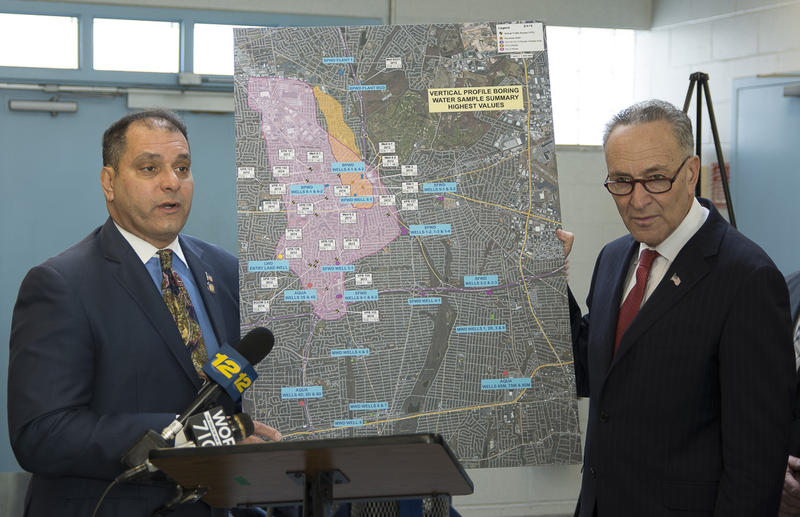 N.Y. Assemblyman Anthony Saladino (left) and U.S. Sen. Charles Schumer (D-NY) display a map of the spread of a plume of toxic chemicals from Bethpage to Massapequa.