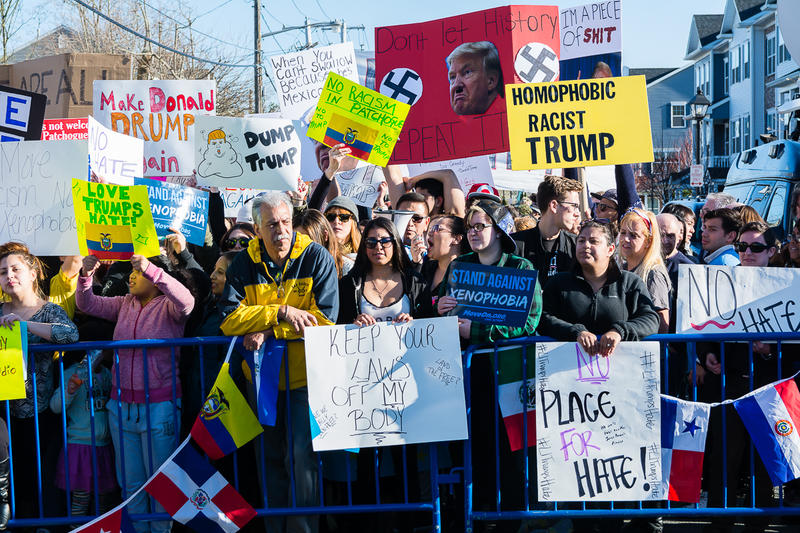 Protesters gather down the block from the Emporium in Patchogue, Long Island to protest Presidential Candidate Donald Trump's fundraiser inside the venue on Thursday, April 14, 2016.
