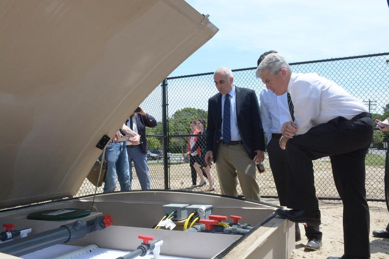 Southampton Supervisor Jay Schneiderman, left, and Suffolk County Executive Steve Bellone inspect a wastewater treatment system in Hampton Bays, L.I.