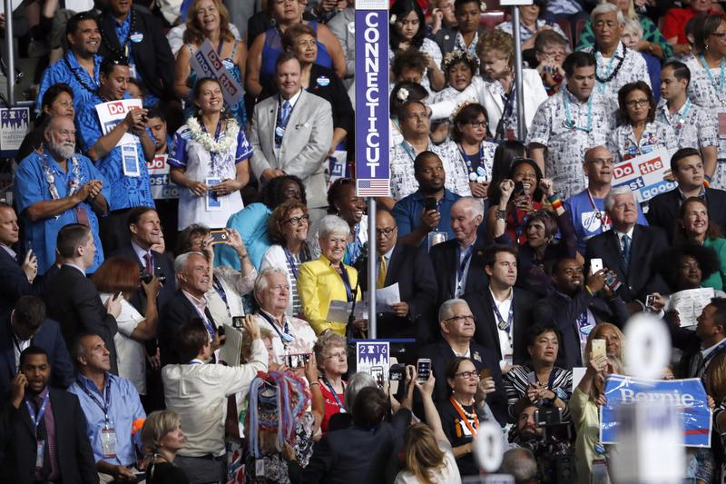The Connecticut delegation casts its votes during the second day of the Democratic National Convention in Philadelphia on Tuesday. Earlier in the day, some members of the delegation participated in a rally for gun control measures..
