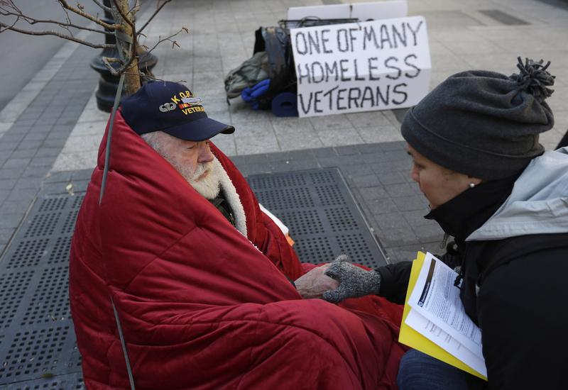 Homeless Korean War veteran Thomas Moore, 79, left, in Boston in 2013.