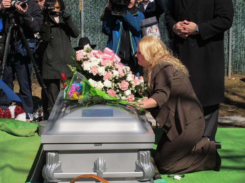 Mari Gilbert at the coffin of her daughter Shannan in 2015 at Amityville Cemetery in Amityville, N.Y. Gilbert was a prostitute whose disappearance in 2010 led to the discovery of ten sets of human remains. Mari Gilbert was found murdered this week.