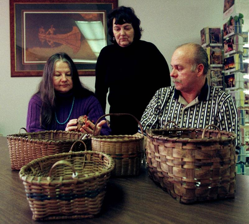 From left, Schaghticoke Indian Tribe Archaeologist Lucianne Lavin, Tribal Historian Paulette Crone-Morange, and Tribal Chief Richard Velky, pose at tribal headquarters in Monroe, Conn., in 1999, with some of the baskets made by their ancestors.