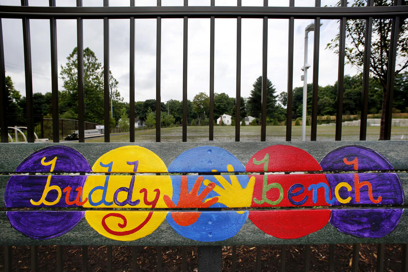 A playground bench is colorfully decorated at the new Sandy Hook Elementary School, Friday, July 29, 2016, in Newtown, Conn. The public is getting its first look at the school which will replace the one torn down after a gunman entered it in December 2012