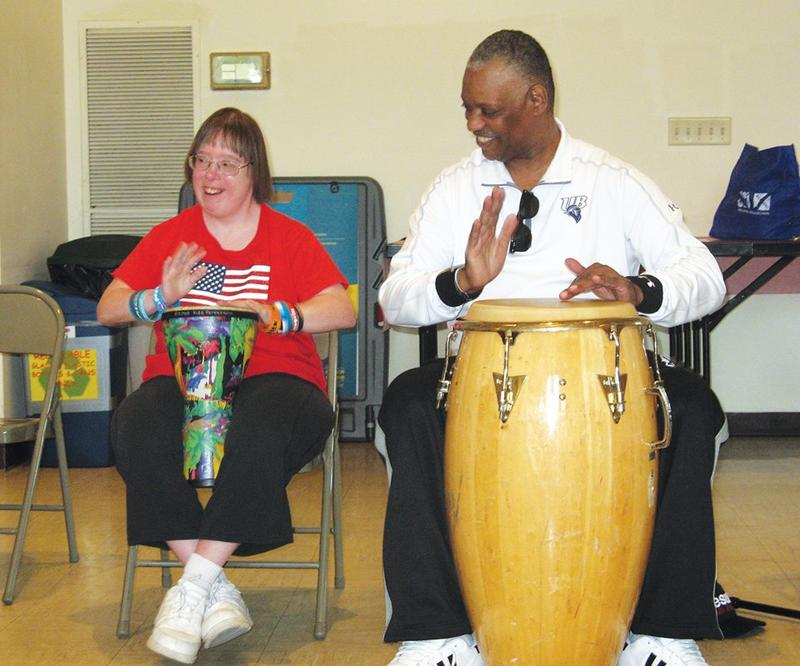 Percussionist Steve Scales leads a drum circle, alongside participant Sherry Berglund, at the Kennedy Center in Trumbull, Conn.