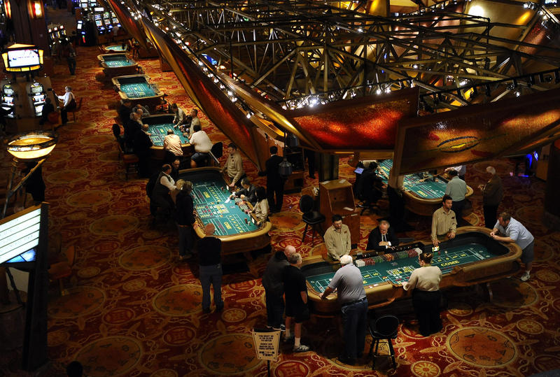 Patrons play craps at Mohegan Sun in Uncasville, Conn.