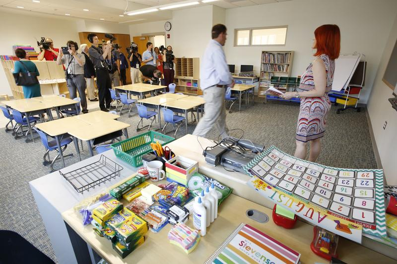 A classroom stocked with fresh school supplies during the open house.