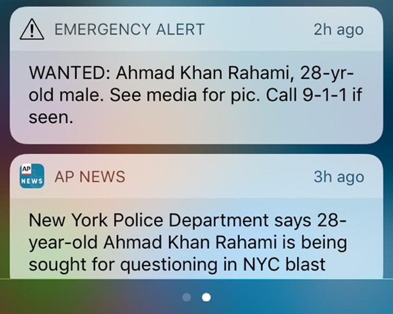 A screen grab from a cellphone shows an emergency alert along with a news alert about a man wanted in connection with explosions in the New York City metropolitan area.