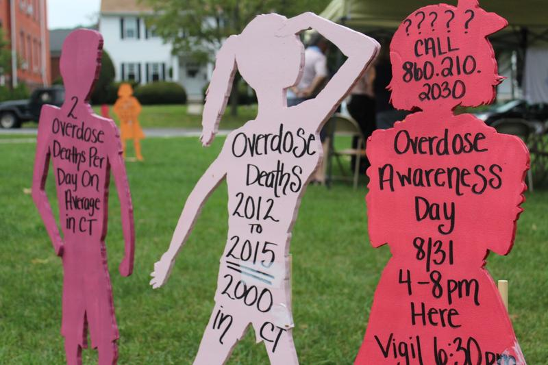 Facts about drug overdoses in Connecticut were written on child-size cutouts and placed at the vigil in New Milford.