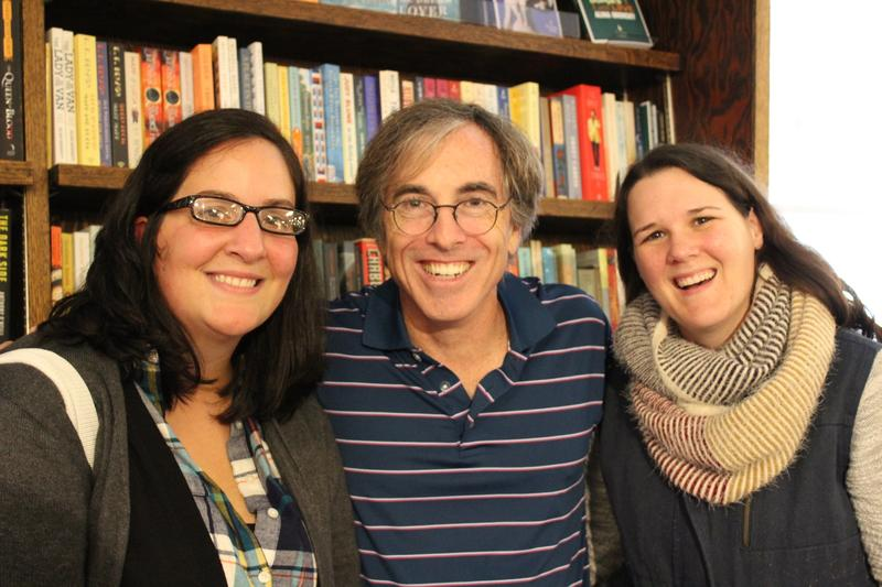 Actor Mike Gandolfi, who played Andrew the bookstore owner in the show, alongside two festival attendees at the Hickory Stick Bookshop.