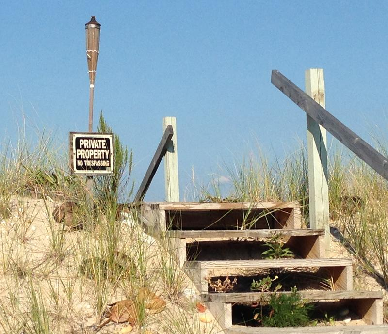 A private property sign village of Asharoken, N.Y., marks beachfront and stairs leading to the beach in 2014.