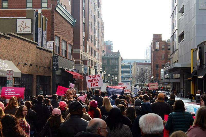 A sea of people head down Summer Street midway through the march.