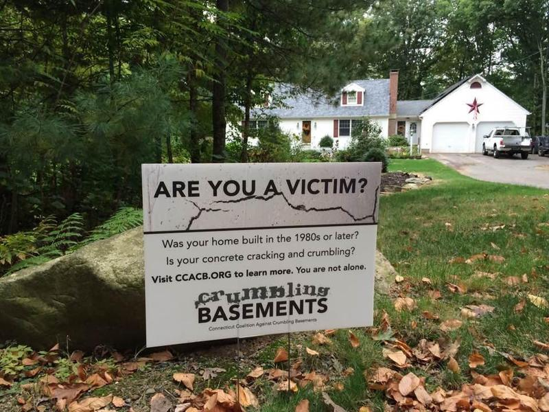 A yard sign by the Connecticut Coalition against Crumbling Basements, an organization that advocates on behalf of homeowners whose residences were made with the affected concrete.