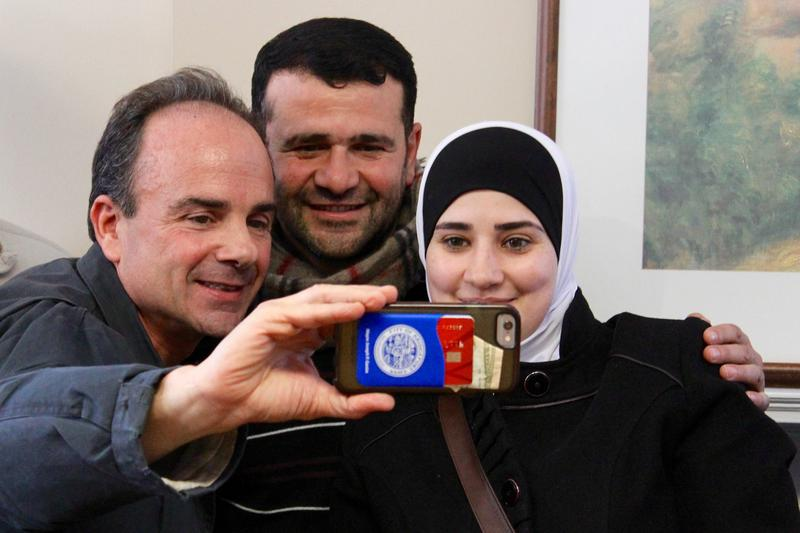 Mayor Ganim takes a selfie with two Syrian refugees.