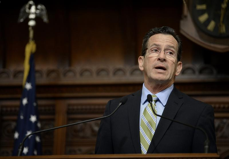 Connecticut Gov. Dannel P. Malloy delivers his budget address to members of the House and Senate inside the Hall of the House at the state Capitol in Hartford, Conn., on Wednesday.