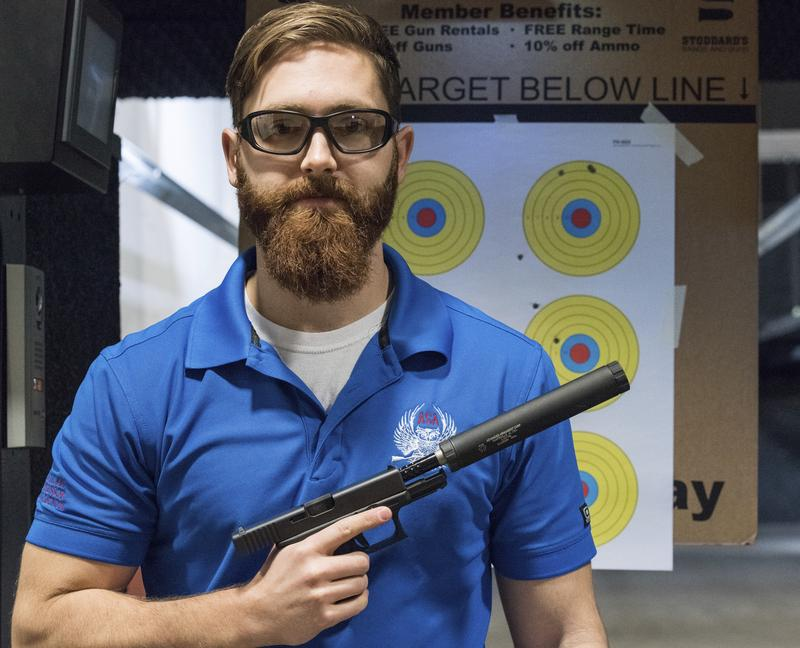 Knox Williams, president and executive director of the Georgia-based American Suppressor Association, poses for a portrait while holding a handgun with a silencer in Atlanta in January.