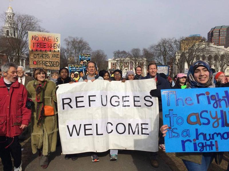 Supporters of refugee resettlement in the U.S. march in Hartford, Conn., in February. Rep. Rosa DeLauro, D-CT3, third from left; Senator Richard Blumenthal, D-Conn., fourth from right; and IRIS Executive Director Chris George holds the sign at middle.
