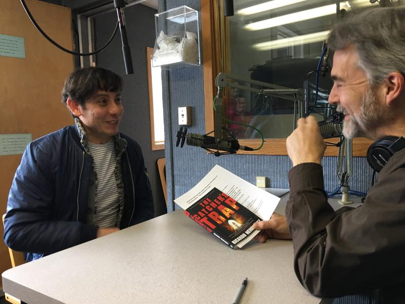 Writer Ricardo Henriquez speaks to Morning Edition Host Tom Kuser about his new book, The Catcher's Trap, at the WSHU studio last week.