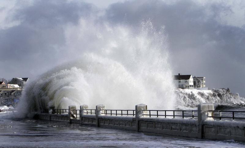 Heavy surf breaks over the seawall during a winter storm, Hampton, N.H.